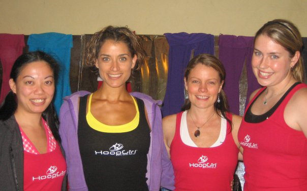 [from right to left] After HoopGirl Level 1 training, graduate Allisone, with Master trainer Candice, HoopGirl creator, Christabel, and HoopGirl All Star, Natasha. November 2007, San Francisco, CA